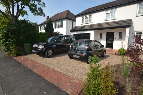 Stabilised gravel driveway with clay paving for rumble strip in Poynton