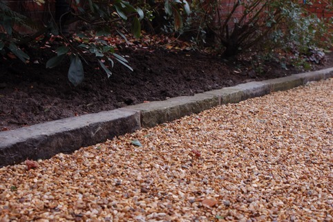 Reclaimed Yorkstone kerb with Stabilised Gravel driveway