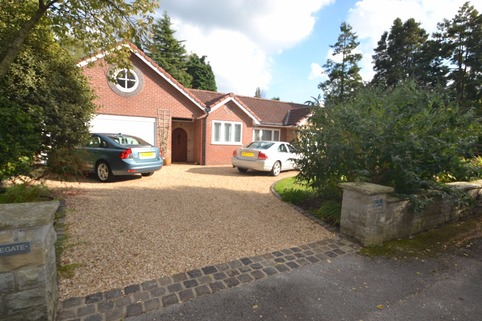 Stabilised Gravel driveway in Bramhall with reclaimed setts and rumble strip