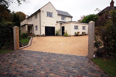 Stabilised Gravel driveway with reclaimed granite setts for rumble strip in Hale