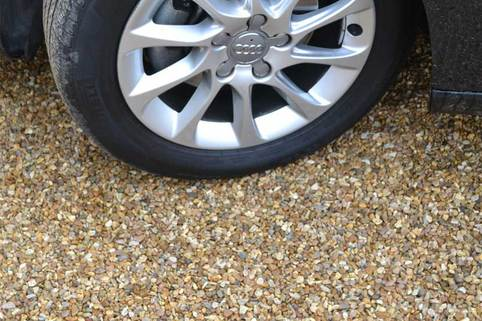 Car wheel turning on Stabilised Gravel driveway