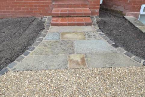 Entrance threshold using reclaimed Yorkstone paving in Stockport
